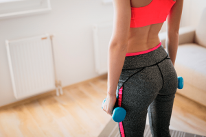 buttocks with dumbbells